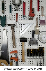 Various carpentry tools in a garage on pegboard