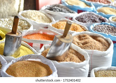 Various cereals in bags on the food market by weight