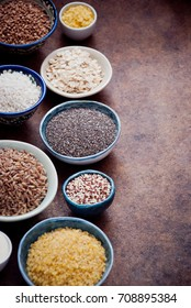 Various cereals and grain in different bowls in rustic style