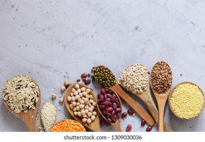 various cereals in wooden spoons, healthy food