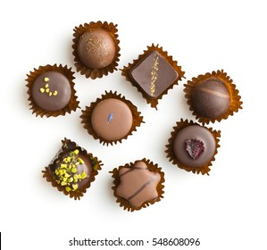 Various chocolate pralines isolated on white background. Top view.