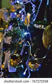 Various Christmas decoration on a Christmas tree.