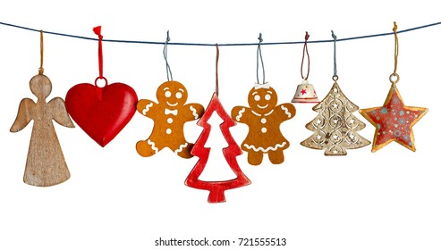 Various Christmas decorations hanging on string isolated on white background