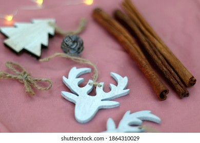 Various Christmas decorations on pink background. Selective focus.