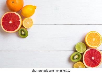 Various citrus fruits on the table. Top view