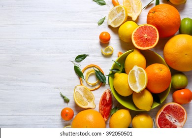 Various citrus fruits on wooden table