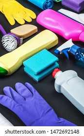 various cleaning products for the house on a black background.
