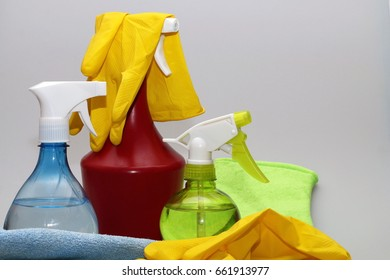 Various cleaning tools (Pulverizers, rubber gloves and rags) on a white background