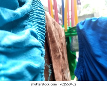various clothes that are being dried under the sun