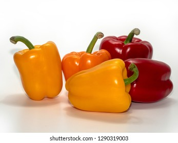 Various colored pepper pods on a white background