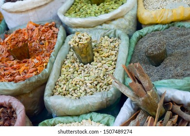 Various colorful essential Indian Himalayas traditional spices, herbs and seasonings in Burlap Sack for display. These contributes five basic tastes sweet sour salty bitter umami to elevate cooking.