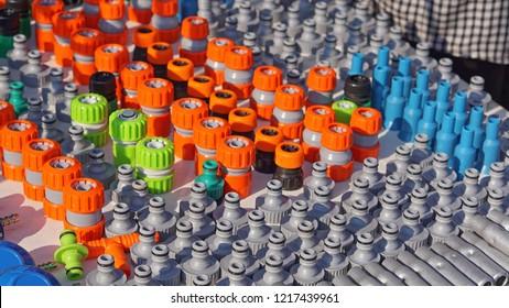 Various colorful garden hose nozzles sprayer valves parts