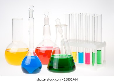 Various colorful glass laboratory ware on a white background