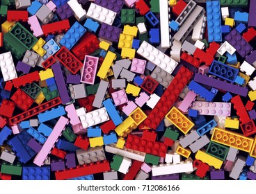 Lot of various colorful Lego blocks background. Many assorted building bricks of bright colors. Educational toy for children