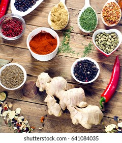 Various colorful spices and fresh herbs on wooden table. Flat lay