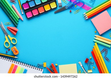 Various colorful stationery on blue background. Back to school frame background with copy space.