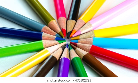 Various colour pencils isolated on white. Bunch of assorted pencils in rainbow arrangement. Back to school and creativity concept. Office and education background. Panorama style.