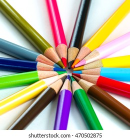 Various colour pencils isolated on white. Bunch of assorted pencils in rainbow arrangement. Back to school and creativity concept. Office and education background