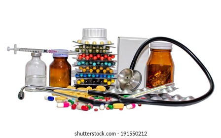 Various colour pills capsule,Syring, stethoscope on a white background