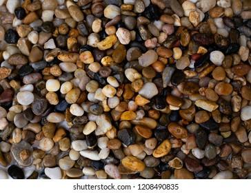 Various coloured pebbles on a beach