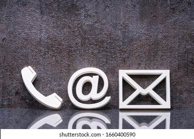 Various Contact Us Methods. White Phone, Email And Post Icons