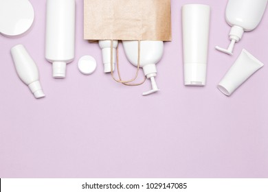 Various cosmetic products with paper packaging bag. Buying cosmetics. Beauty shopping. Copy space