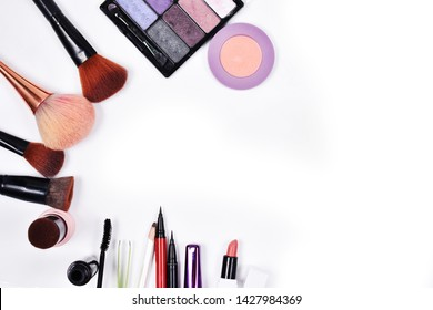 Various cosmetics placed on a white background