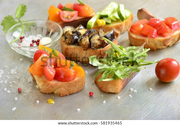 Various crostini with vegetables and herbs