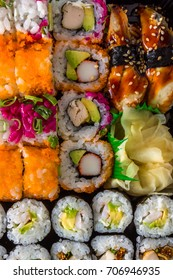 Various delicious Types of Sushi Rolls. Top view.