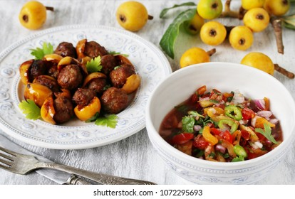 various dishes from medlars. meatballs with a loquat. fruit salsa with a loquat. recipes with a medlar.