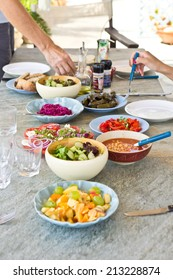 Various dishes on an outside dining tabke