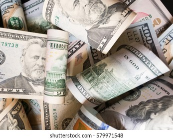 A lot of various dollar banknotes close up view background wallpaper