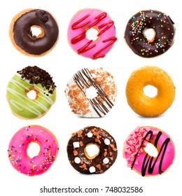 various doughnuts on white background