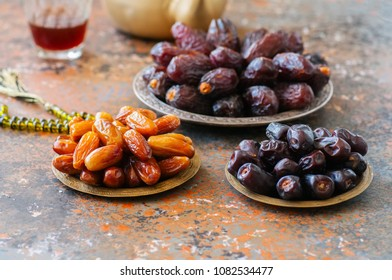 Various of dried dates or kurma in a vintage plates and tea