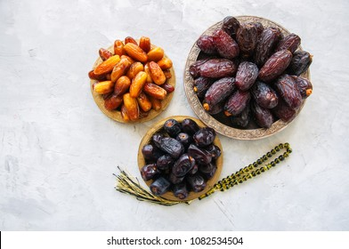 Various of dried dates or kurma in a vintage plates. Top view