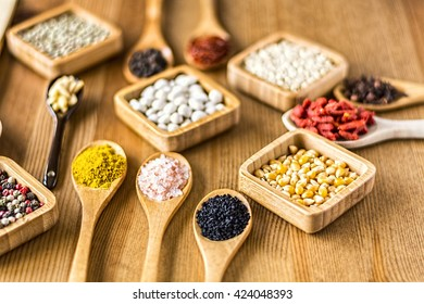 Various dried legumes and spices on old wooden table. Colorful Top View