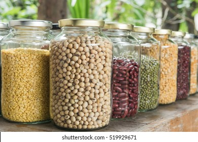 Various dry legumes in a glass jar