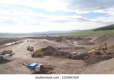 Various earthworks (excavation, transporation of fill materials, stockpiling, crushing and cleaning of rock, etc.) during a highway / road construction project