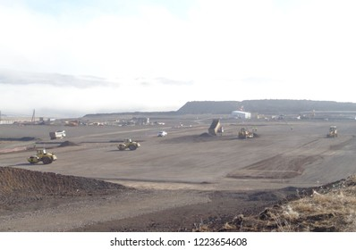 Various earthworks (excavation, transporation of fill materials, stockpiling, filling, compaction, etc.) during a highway / road construction project