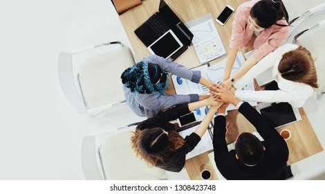 Various ethnicity Many business people join hands demonstrate harmony. Determination to work successfully achieved goal. Work together. Teamwork requires clear division work to achieve the goal.