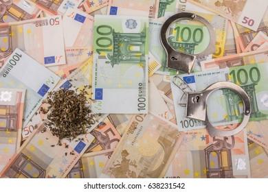 Various euro banknotes, marijuana and handcuffs