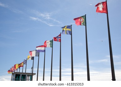 Various European flags against the blue sky