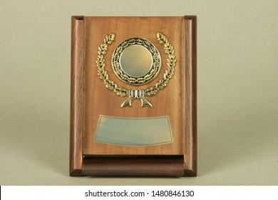 Various examples for awards or memorabilia. Award made of wood and precious metals.