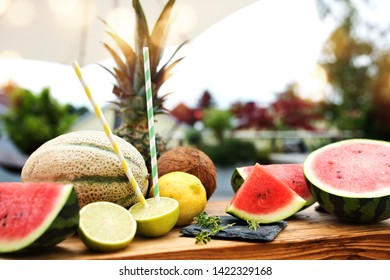 Various exotic fruits in summer on a rustic wooden table
