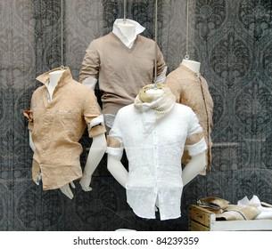 various fashionable men's shirt in shop window