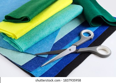 Various Felt Fabric Sheets and Scissors