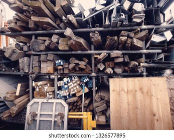 Various fence posts and wooden beams at a salvage yard in the UK.