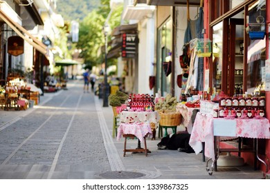 Various food and goods sold at small shops at the pedestrian area at center of Kalavryta town near the square and odontotos train station, Greece.