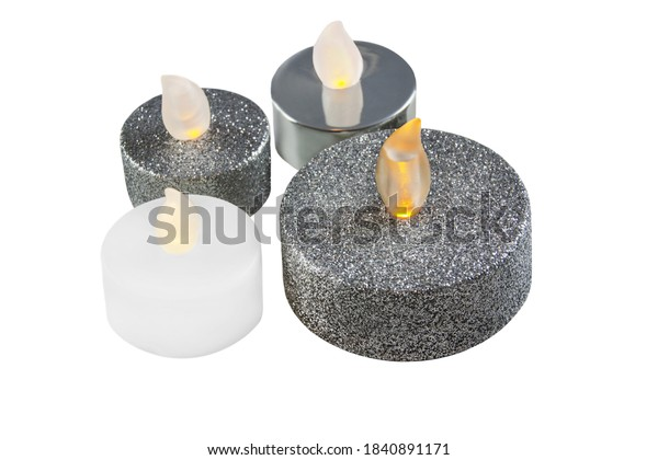 Various four LED candles close up isolated against white background