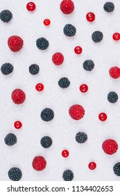 Various fresh berries on light textured table, top view.